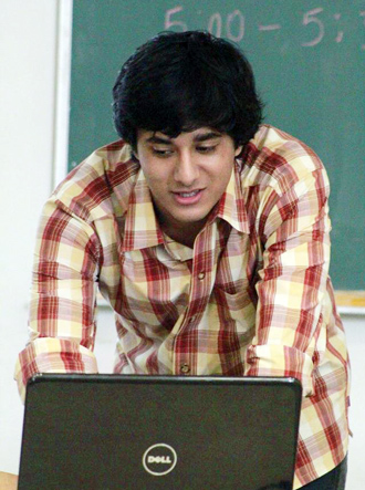 Aniket Pant, working on his laptop